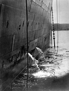 Giant starboard anchor of the Titanic is raised for the last time. 1.55pm 11th April 1912 in a picture taken by Father Browne.