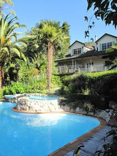Havelock House B&B luxury bed and breakfast spacious ensuite bedrooms quiet location close to Napier central Havelock North Hawkes Bay NZ. Havelock North, Holiday Park, Bed And Breakfast, Luxury Bedding, New Zealand, Swimming Pools, Landscape, Outdoor Decor, House