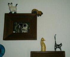 these cats are in my bedroom over the frames of the pictures . Wooden Cat, Liquor Cabinet, My House, Frames, Collections, Bedroom, Cats, Pictures, Furniture