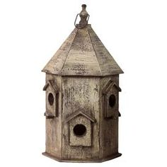 """Distressed wood birdhouse with conical roof.   Product: BirdhouseConstruction Material: WoodColor: Brown  Features: Suitable for outdoor use  Dimensions: 22.5"""" H x 12"""" DiameterCleaning and care: Wipe with a damp cloth"""