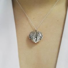 Sterling silver locket in the shape of angels wings. Can keep loved ones photos close to heart  - Shop now > http://ift.tt/1Ja6lvu