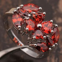 'Fabulous Created Red Garnet Ring' is going up for auction at 11am Thu, Dec 6 with a starting bid of $8.