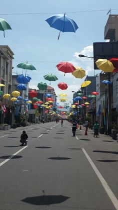 So many umbrellas hanging up. Borneo, Universal Studios Singapore, Bali, Photoshoot Inspiration, Street Photography, Tourism, Street View, Places, Travelling