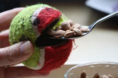 color face onto tennis ball, spoon in nuts, then regurgitate seeds back into cup - Make it an owl and call it owl pellets?