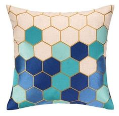 Trina Turk's Carlsbad blue pillow makes the classic honeycomb pattern bright and fresh. A stunning mix of turquoise, pacific blue, and cobalt blue is artfully arranged and accented with gold for moder