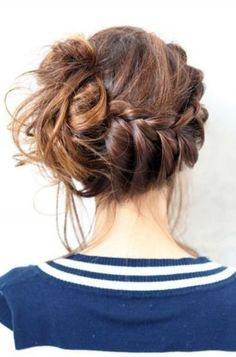 braided updo with a messy knot