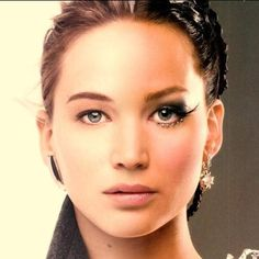 Symbolic of the contrast between how Katniss truly is, and what the Capitol makes her out to be.