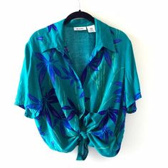 """Vintage Hawaiian Blue Green Button Down Shirt Vintage tropical/hawaiian blue/green flower print lightweight button down, can be worn tied or open casually. There are tiny pulls in the fabric near the arm (see picture) but they aren't noticeable, fabric is still very soft! Measures 25"""" long, 22"""" across and 10"""" sleeves. Open to offers, cheaper on Ⓜ️ercari! BUNDLES SAVE 10%! Tags: vintage hawaiian shirt Zara brandy Melville forever 21 h&m free people American apparel vintage urban outfitters…"""