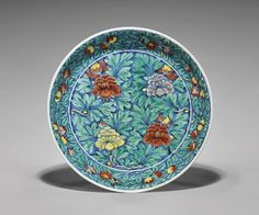 """Rare and large, Chinese Ming Dynasty, Wanli Mark and of the Period, underglazed blue and enameled porcelain dish; depicting a bold design of four peonies on a dense ground of foliage. D: 13 1/4"""""""