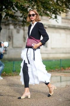 Ditch the leggings. Wear skinny jeans under a light and frilly skirt or dress. See all the best street style at Paris Fashion Week: #ditch