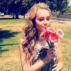 I love this picture of Bridget Mindler, the flowers, location, and lighting!!