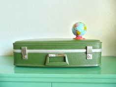 Beautiful home organization hack: Vintage suitcases make great video game controller storage to keep them in plain sight, but out of the way. | AirFare on Etsy