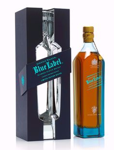 Johnnie Walker Blue Label, the pack presents a play on facets, light & reflection. This rigid board pack is covered in a premium colour stock paper with a subtle bespoke texture. The pack is secured by a gloss laminated magnetic band with the branding in metallic blue foil. Open the pack up and you are presented with a chrome plated, mirror finished injection moulding with integral neck clip. With its split opening at the front and back the colour of the whisky is reflected back at the…