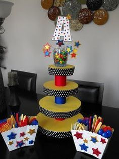 DIY cupcake stand with cake rounds, glue gun, cans, ribbon and card stock Monster Birthday Parties, Elmo Party, Superhero Birthday Party, 3rd Birthday Parties, Birthday Ideas, Birthday Boys, Batman Party, Circus Party, Monster Party