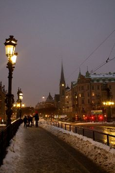 I snapped this travel photo on an afternoon in late December in Stockholm, Sweden, just after leaving the Vasa Museum. Even though it couldn't have been later than 3:30 in the afternoon, the sun had nearly completely set, and snow loomed in the clouds.