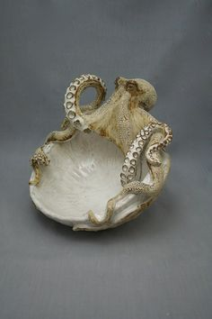 Ceramic Octopus Bowl by Shayne Greco. size measures aprx 11x13x7. The glazes used are lead free. Artwork is completely hand built. Please feel free to visit our web sight www.shaynegreco.com . Like us on Facebook Shayne Greco Ceramics. PLEASE NOTE!!!!!!!You are purchasing this item as a