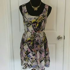 100% Silk Urban Outfitters Fit & Flare Dress Super rare, I can't find this dress anywhere any longer. 100% silk overlay and slip. Awesome sundress for spring and summer. Gorgeous bright colored abstract pattern. Size S. Urban Outfitters Dresses Mini