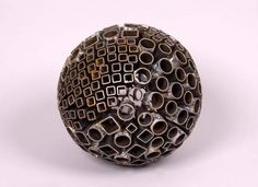 """Mark Castator (FB) creates planets and moons from hundreds of small scrap metal pieces called """"droppings"""" leftover form other sculpting projects. He's created dozens of these incredible spheroid objects for this series entitled Moons of Jupiter."""