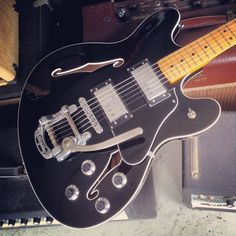 fender starcaster with bigsby fitted.