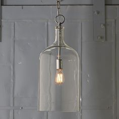"""Glass Jug Lantern  Our better-quality glass jug lantern has thicker glass and repurposed-vintage charm with modern flair. Polished nickel hardware. Add a vintage """"Edison"""" bulb for even more style.   150 watts (medium base socket).   (22.75""""Hx10""""W)   6' chain   5"""" canopy"""