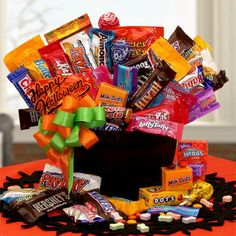 Gift Baskets Oxeme Gifts Double, Double, Toil and Trouble! Our Witches cauldron is filled to the brim with the best Halloween candy one could want. It has all the classic chocolate and candies your little goblins will devour this Halloween. This years best Halloween gift for sure! The Happy Halloween Candy Cauldron Of Treats includes: 2 lbs. of Assorted Chocolate Candies from Mars, Nestle and the Hershey's Companies, Milky Way, Snickers, Three Musketeers, Twix, Baby Ruth, 100 Grand Nestle…