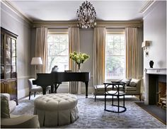 All the features of a great away room. Piano, fireplace, comfortable seating and bookcases.