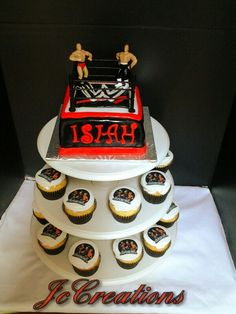 WWE Cake!!! Chelsea I like this idea.... cupcakes and a small cake on top!