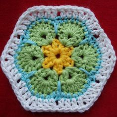 Afrikaanse bloem haken - crochet African flower (nederlands patroon, with link to English pattern). (Als basis voor sommige prachtige knuffels van Heidi Bears)