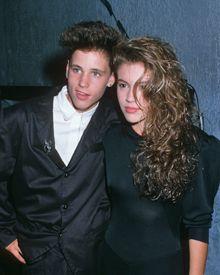 Alyssa Milano & Corey Haim. I sooo hated her cause I loved him so much!