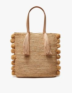 Large tote from Loeffler Randall in Natural. Long top handles with leather tassel accent. Straw pom poms at sides. Structured leather base. Organizer panel at interior with two slot pockets and one zip pocket.  • Raffia • Leather accents