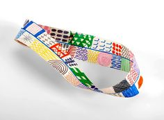 Make a Mobius strip with colorful lines, shapes, and mathematical patterns. Cut it in half and watch the magic happen!