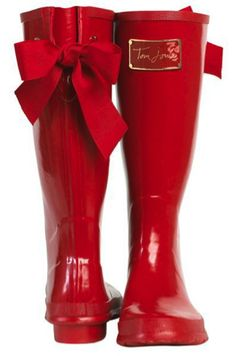 I want these!  Cute red rain boots {love the bows}