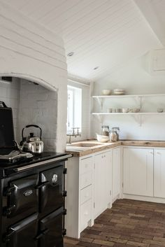 white painted shaker kitchen with open shelving and aga and reclaimed wooden floorboards Farmhouse Style Kitchen, Country Kitchen, New Kitchen, Kitchen Dining, Shaker Kitchen, Kitchen Shelves, Kitchen Tools, Kitchen Ideas, Layout Design