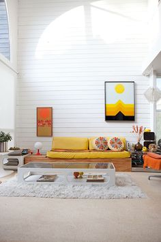Sunny Yellow Wall Art 15 Ways To Pump Up Your Pad With Color #refinery29 http://www.refinery29.com/home-color-trends#slide10 Use bursts of color for visual pop. A white-painted room (hello, rental apartment) is the perfect backdrop for a color party. Stick to one or two tones for the most impact. Here, a sunny-yellow sofa, juicy-orange chair, and matching art instantly draw the eye, while the other furnishings — tables, rug — in bright white keep the space from feeling chaotic.