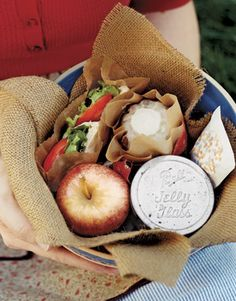 Summer Picnic Recipes, like this fun idea: individually packed lunches for each person: a pita sandwich wrapped in waxed paper, a vellum bag filled with crackers, a jelly jar filled with Lentil and Couscous Salad with Mint, a tiny cake that was baked in a Jell-O mold, and a fresh Gala apple.