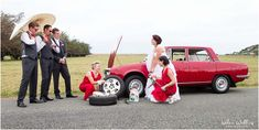Fun bridal party photos with red Audi wedding cars