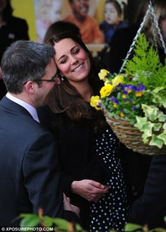 On form: The Duchess was on cheerful form as she chatted happily to Home-Start Chief Execu...