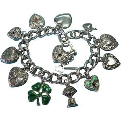 This is a lovely sterling silver Victorian repouse design hollow link bracelet. The bracelet measures 7 5/8 in length with the padlock attached by
