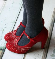 Low, semi-thick heels with t-strap in red. No higher than 2 inches