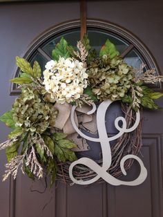 Beautiful grapevine wreath with 3 gorgeous hydrangea blossoms: 2 green and 1 cream in the middle, surrounded by hydrangea leaves and additional greenery and fillers, accented with double burlap bow. Made on 18base , finished wreath measures approximately 19-20in diameter.  Add monogram of your choice for a personal touch .  This lovely wreath will make a nice addition to your own home, as well as a thoughtful gift for a special person or occasion.  All our wreaths are made in smoke and pet…