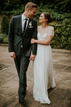 Shustoke Farm Barns wedding. Photo: D&A Photography  Dress: Phoebe Blockley Bridal. Silk tulle skirt, lace sleeves.  #bride #groom #lace #wedding #dress #hugoboss #couple #portrait