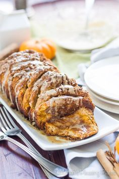 A cinnamon roll inspired treat, this Pumpkin Maple Pull Apart Bread is a decadent breakfast or dessert option. The Maple Cinnamon Glaze is perfect for drizzling or dunking!