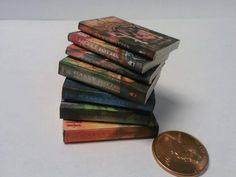Harry Potter miniature books for dollhouse or miniature collections- Not a charm. $20.00, via Etsy.