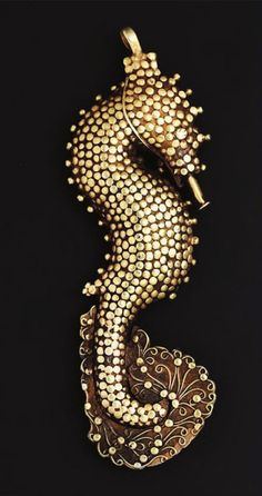 """Using fine granulations and filigree, the goldsmith has recreated the scales and fines of a seahorse on this pendant (Gold alloy, 19th century). This piece found in Flores, but originates from Makassar, South Sulawesi."" 