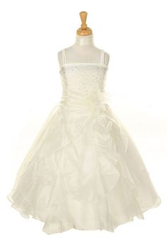 This breathtaking sleeveless dress comes with an intricately gradient beaded bodice. If that is not enough detail, take note of the numerous layers of scallop hemmed organza throughout the skirt. Truly fit for a princess! This style comes with a removable pin on flower adorned with beading. Sash is attached to side seams of dress and ties in back. NOTE: Infant sizes are sleeveless while sizes 2-14 come with spaghetti straps.
