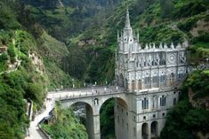 Las Lajas Sanctuary is a minor basilica church located in the southern Colombia.  Las Lajas Sanctuary is a minor basilica church located in the southern Colombia.   An example of Gothic Revival architecture, the cathedral is memorably framed by stark mountains and 100 feet waterfalls. Source: http://been-seen.com/travel-blog/places-to-go/las-lajas-cathedral