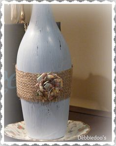 Repurposed wine bottle ideas... you can start with just a bit of paint and burlap