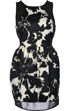 Graphic Garden Dress: Features a silky satin composition with bold monochrome botanical pattern to both sides, black mesh paneling bordering the bodice, light gathering to the waist, and a mesh border surrounding the hem to finish.