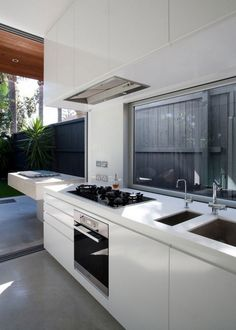 'Like how the outdoor grille design matches the line of the kitchen. Unique detail. Creative. North Bondi House was completed by Australian studio MCK Architects and is located in Bondi, a suburb of Sydney, Australia. (Click on photo for a slightly larger image.) More photos found here: http://freshome.com/2011/10/04/a-delightful-australian-home-north-bondi-house-by-mck-architects/
