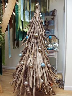 Celebrate Christmas with some coastal flair. This driftwood beauty is both creative and classy.